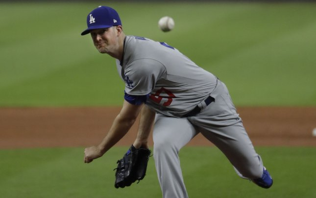 Alex Wood and the Los Angeles Dodgers take on the Los Angeles Angels on Sunday. Pool Photo by Matt Slocum/UPI