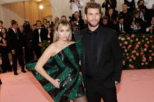 Liam Hemsworth (R), pictured with Miley Cyrus, will star in a new show from short-form streaming company Quibi. File Photo by John Angelillo/UPI