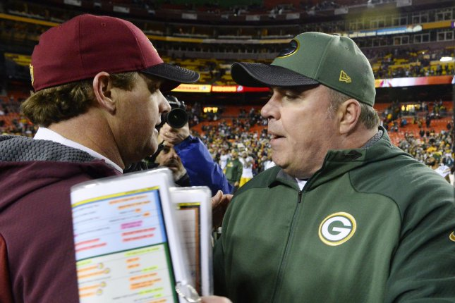 Former Green Bay Packers head coach Mike McCarthy (R) was fired by the Packers midway through the 2018 season. File Photo by David Tulis/UPI