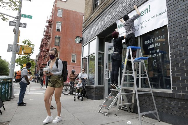 Customers are seen outside a Starbucks franchise in the East Village neighborhood of Manhattan in New York City on May 28. File Photo by John Angelillo/UPI