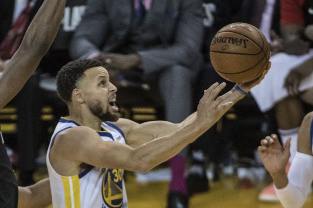 Golden State Warriors guard Stephen Curry scored 21 of his career-high 62 points in the first quarter in a win over the Portland Trail Blazers on Monday in San Francisco. File Photo by Terry Schmitt/UPI