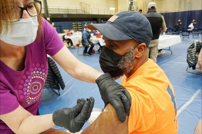 A man receives a dose of Johnson & Johnson's COVID-19 vaccine at St. Louis Community College at Forest Park in St. Louis, Mo., on March 25. Photo by Bill Greenblatt/UPI