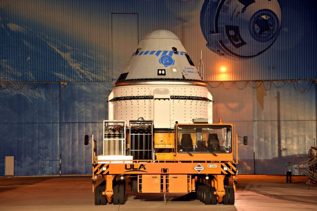 Boeing's Starliner spacecraft rolls from its processing facility at the Kennedy Space Center in Florida on Saturday. It was towed to Complex 41 and lifted onto its Atlas V rocket as it is prepared for a July 30 launch. Photo by Joe Marino/UPI