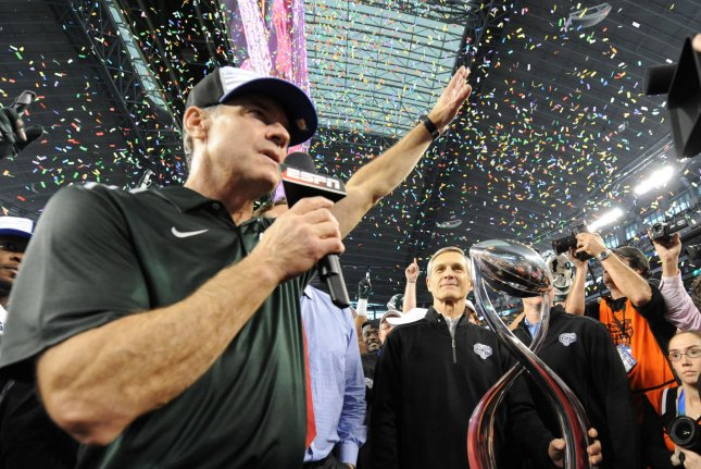 Michigan State head coach Mark Dantonio accepts the Field Scovell trophy after defeating the Baylor Bears 42-41 in the Goodyear Cotton Bowl Class in AT&T Stadium, Arlington, Texas on January 1, 2015. File photo by Ian Halperin/UPI