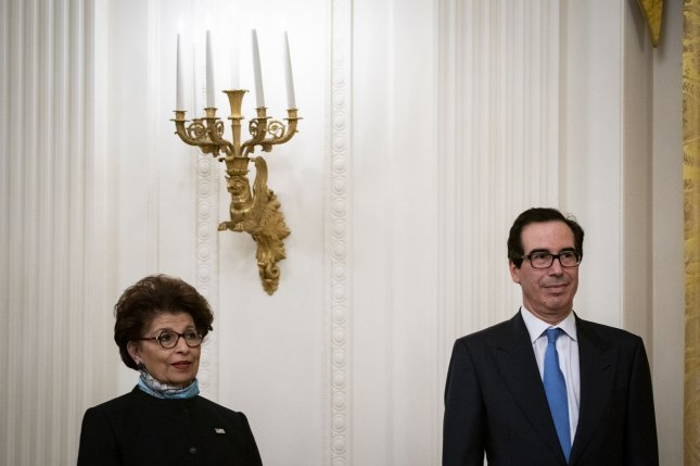 Jovita Carranza, administrator of the U.S. Small Business Administration and Treasury Secretary Steven Mnuchinlisten during a Paycheck Protection Program event in the East Room of the White House in Washington, D.C., U.S., on Tuesday, April 28, 2020. File Photo by Al Drago/UPI