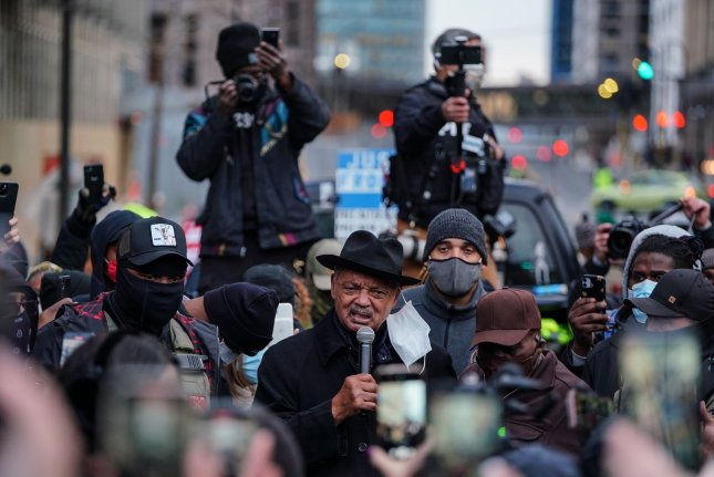 The Rev. Jesse Jackson speaks to protesters outside the temporary location of the Third Police Precinct during a march through downtown Minneapolis on Monday as jury deliberations began in the Derek Chauvin trial. Photo by Jemal Countess/UPI