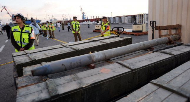 Israeli soldiers stand by a display of Iranian supplied arms seized by Israeli commandos at the Ashdod Port on November 4, 2009. The Israeli Navy intercepted the Antiqua-flagged Francop vessel in the Mediterranean Sea carrying hundreds of tons of Iranian supplied arms bound for Syria. UPI/Debbie Hill