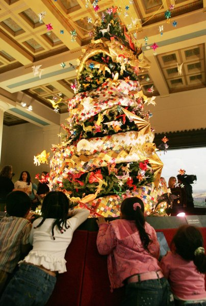 Head Start intervention helps child behavior, lowers parental stress. Children from the Goddard Riverside Head Start program look at a holiday tree decorated with origami ornaments which is on display at the American Museum of Natural History (UPI Photo/Monika Graff)