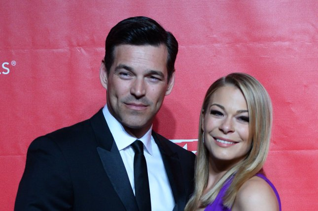 LeAnn Rimes (R) and husband Eddie Cibrian at the MusiCares Person of the Year gala for Carole King on January 24, 2014. The couple married in 2011. File Photo by Jim Ruymen/UPI