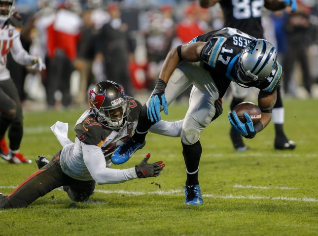 Carolina Panthers wide receiver Devin Funchess, right, breaks free from Tampa Bay Buccaneers cornerback Johnthan Banks to score a touchdown during a recent game. Photo by Nell Redmond/UPI