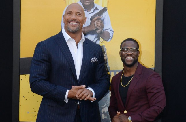 Jumanji: Welcome to the Jungle, starring Dwayne Johnson and Kevin Hart, is the No. 1 movie in North America for a third weekend. File Photo by Jim Ruymen/UPI