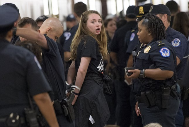 Demonstrators are arrested as they protest Supreme Court Justice nominee Brett Kavanaugh outside the office of Sen. Susan Collins, R-Maine, on Capitol Hill on Monday. Photo by Kevin Dietsch/UPI