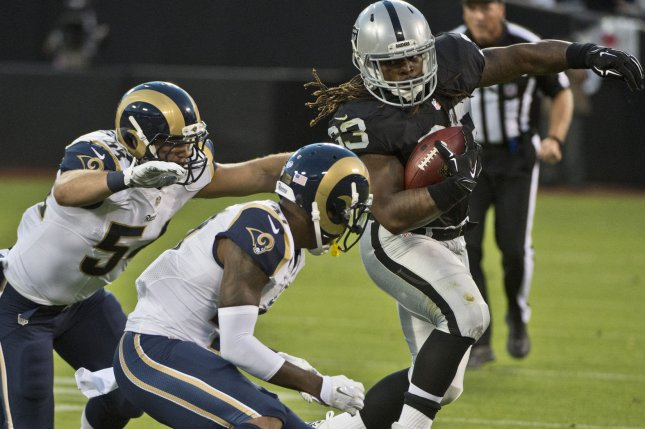 Former Oakland Raiders running back Trent Richardson (33) scored the first two touchdowns in Birmingham Iron history in a win against the Memphis Express on Sunday in Birmingham, Ala. File photo by Terry Schmitt/UPI