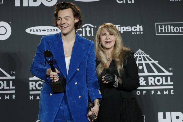 Stevie Nicks (R) and Harry Styles pose together at the 34th annual Rock and Roll Hall of Fame induction ceremony on March 2019. iHeartRadio has announced anew podcast series that features iconic induction speeches. File Photo by John Angelillo/UPI