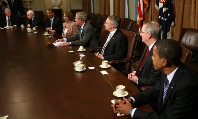 U.S. President George W. Bush prepares to host a meeting with Republican and Democratic Congressional leaders to discuss the current economic crises in the Cabinet Room of the White House on September 25, 2008. From left are House Majority Leader Steny Hoyer, D-MD, Republican Presidential Nominee Sen. John McCain, AZ, House Minority Leader John Boehner, R-OH, Speaker of the House Nancy Pelosi, D-CA, Bush, Senate Majority Leader Harry Reid, D-NV, Senate Minority Leader Mitch McConnell, R-KY, and Democratic Presidential Nominee Sen. Barack Obama, IL. The administration and Congress are nearing a deal on an economic bailout package. (UPI Photo/Kristoffer Tripplaar/POOL)