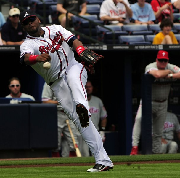 Atlanta Braves third baseman Juan Francisco fields a bunt by Philadelphia Phillies batter Juan Pierre, who was safe at first base, in the first inning at Turner Field in Atlanta on May 3, 2012. UPI/David Tulis