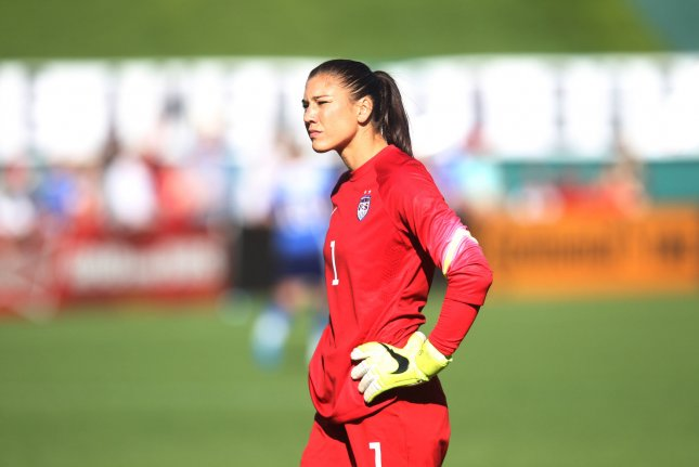 USA's goalkeeper Hope Solo looks to the crowd after making a difficult move against New Zealand in the first half of their match at Busch Stadium in St. Louis. File photo by Bill Greenblatt/UPI