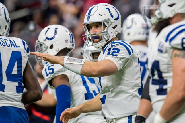 7628cc9c0 Indianapolis Colts quarterback Andrew Luck celebrates a touchdown pass  against the Houston Texans in the second quarter of their Wild Card playoff  game on ...