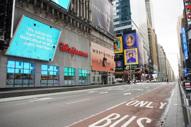 Pedestrian and automobile traffic in Times Square remains almost non existent in New York City on Monday, roughly two months after spread of the novel coronavirus forced businesses to close and people to practice social distancing. Photo by John Angelillo/UPI