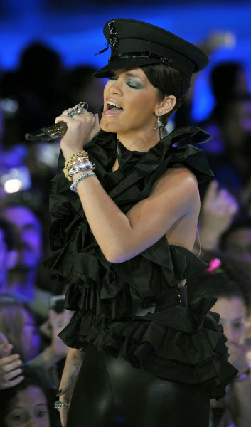 Rihanna performs on an outdoor stage before thousands of fans on Queen Street West at the MuchMusic Video Awards in Toronto, Canada on June 15, 2008. Rihanna, an audience favorite, won the Best International Video Artist Award for Don't Stop The Music. (UPI Photo/Christine Chew)