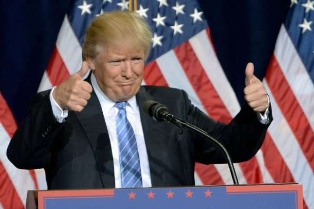 Donald Trump gives the thumbs up during a speech in Arizona last week. On Tuesday, Trump received the endorsesment of 88 retired military leaders. Photo by Art Foxall/UPI