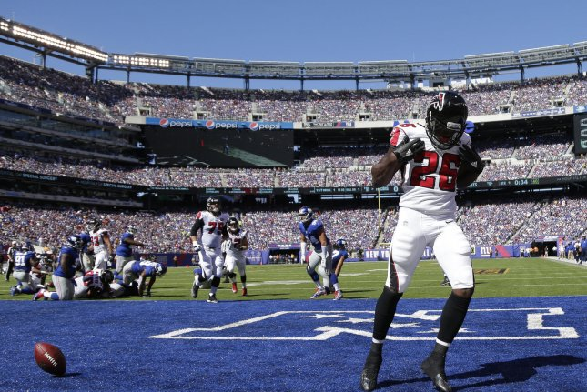 Atlanta Falcons' Tevin Coleman celebrates after scoring on a 1 yard touchdown run in the first quarter against the New York Giants at MetLife Stadium in East Rutherford, New Jersey on September 20, 2015. The Falcons defeated the Giants 24-20. Photo by John Angelillo/UPI