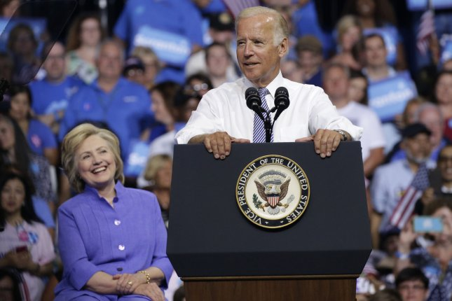 Democratic presidential nominee Hillary Clinton looks on as Vice President Joe Biden speaks on her behalf at a campaign rally in his native Scranton, Pa., in August. Biden is reportedly at the top of Clinton's wish list to serve as secretary of state. File Photo by John Angelillo/UPI
