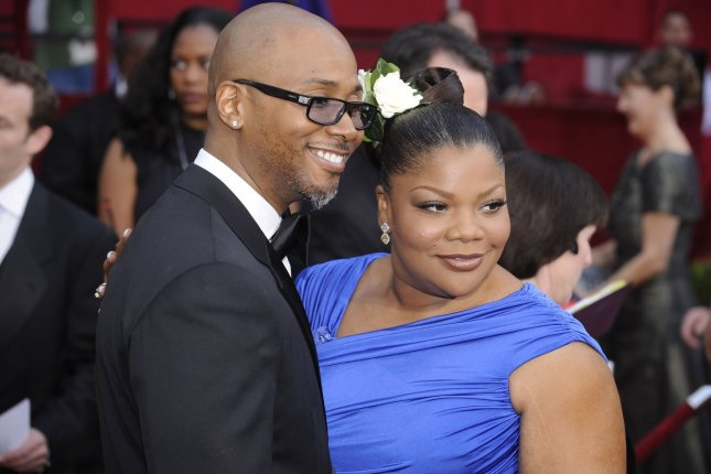 Mo'Nique (R) and her husband Sidney Hicks arrive at the 82nd annual Academy Awards on March 7, 2010. File Photo by Phil McCarten/UPI