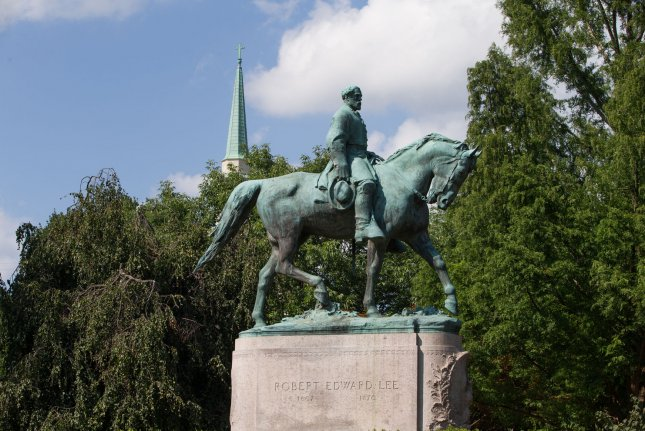 A statue of former Confederate Gen. Robert E. Lee stands in Charlottesville, Va., on August 17. Wednesday, ESPN said it reassigned announcer Robert Lee to cover a different college football game next month, instead of a game he was supposed to call at the University of Virginia. Photo by Erin Schaff/UPI