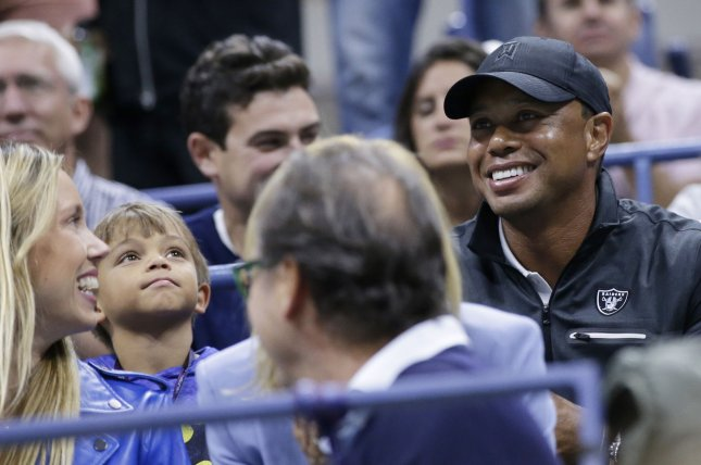 Tiger Woods and son Charlie Axel watch tennis at the 2017 US Open Tennis Championships at the USTA Billie Jean King National Tennis Center on Friday in New York City. Nadal defeated del Potro in 4 sets to advance to the US Open Men's Final. Photo by John Angelillo/UPI