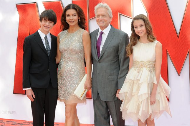 Catherine Zeta-Jones (second from left), pictured with son Dylan, husband Michael Douglas and daughter Carys (L-R), dedicated a sweet message to Douglas on their 17th wedding anniversary. File Photo by Paul Treadway/UPI