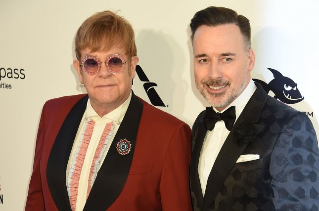 Elton John (L), pictured with David Furnish, rang in his birthday with Furnish and their two sons. File Photo by Gregg DeGuire/UPI