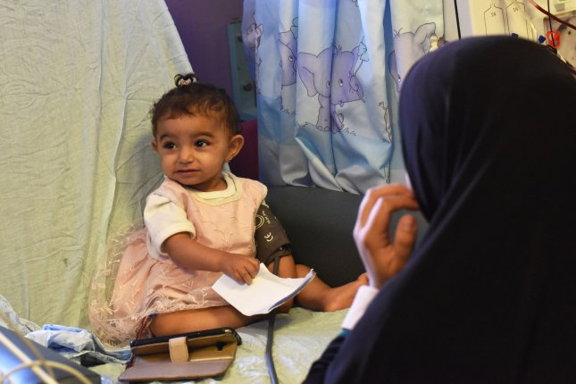 A Palestinian girl is treated for renal failure at Augusta Victoria Hospital in East Jerusalem, Monday. The East Jerusalem Hospital Network, which includes August Victoria, said a U.S. decision to cut $25 million in aid will cause great harm. Photo by Debbie Hill/UPI