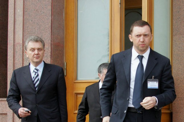 Russian oligarch Oleg Deripaskaoto,, shown here at right in this 2006 file photo, filed a lawsuit against the U.S. Treasury over sanctions imposed on him. Photo by Anatoli Zhadanov/UPI