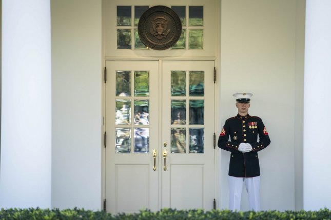 A Marine is seen on duty outside of the West Wing as President Donald Trump returned to the Oval Office Wednesday, days after leaving the hospital following treatment for COVID-19. Photo by Sarah Silbiger/UPI