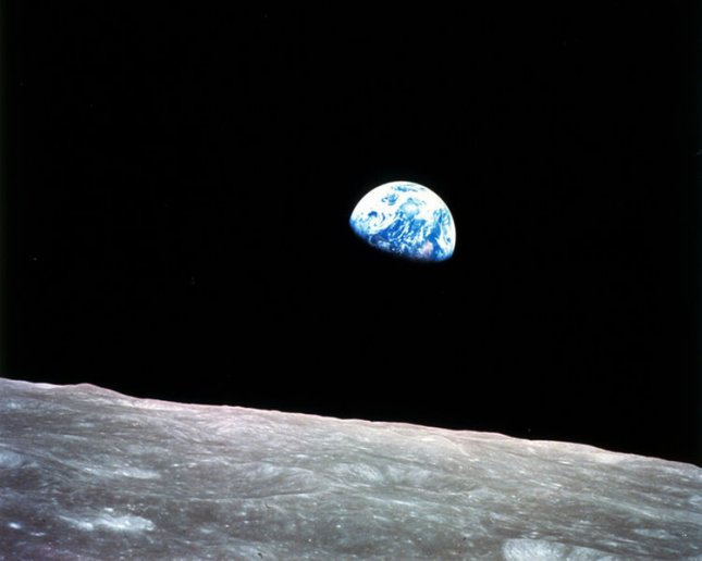 This photo -- over the moon's horizon -- was taken by the Apollo 8 crew in December 1968. It showed Earth for the first time as it appeared from deep space. Astronauts Frank Borman, James Lovell and William Anders were on the spacecraft, which orbited the moon 10 times and returned to Earth Dec. 27, 1968. NASA photo/UPI/File