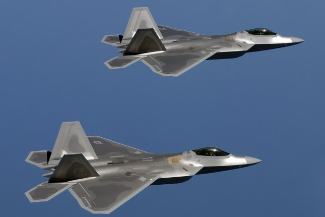 Several F-22A Raptors are being deployed to Europe as part of large-scale wargames being held in the region. Pictured, two F-22A Raptors fly over Langley Air Force Base, Va., on Sept. 9, 2005. File photo by Ben Bloker/DOD/UPI