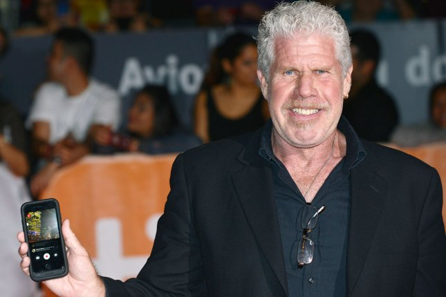Trollhunters voice actor Ron Perlman films the event on his cellphone as he arrives at the world premiere of Stonewall at the Toronto International Film Festival on September 18, 2015. File Photo by Christine Chew/UPI