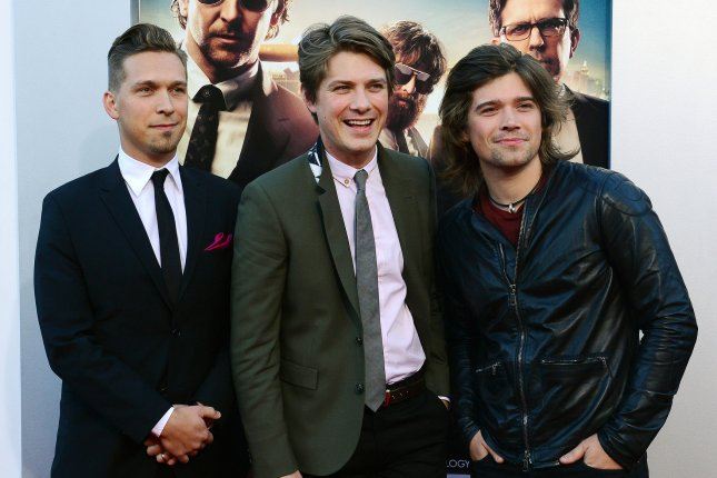 Zac Hanson (R) with brothers Isaac Hanson (L) and Taylor Hanson at the Los Angeles premiere of The Hangover on May 20, 2013. The drummer welcomed his fourth child Saturday. File Photo by Jim Ruymen/UPI