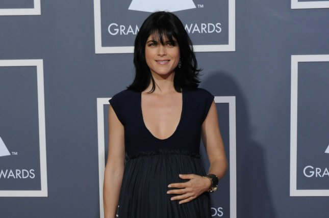 Selma Blair arrives at the Grammy Awards in 2011. Blair recently appeared on The Talk to discuss her psychotic blackout on a flight in June. File Photo by Jim Ruymen/UPI