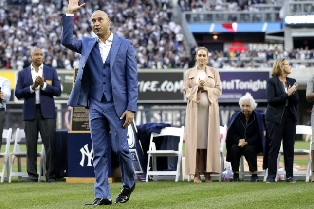 Derek Jeter waves to fans on the field with at a ceremony retiring his number before the Houston Astros play the New York Yankees at Yankee Stadium in New York City on May 14, 2017. The New York Yankees former shortstop had his No. 2 retired and was also honored with a plaque in Monument Park. Photo by John Angelillo/UPI