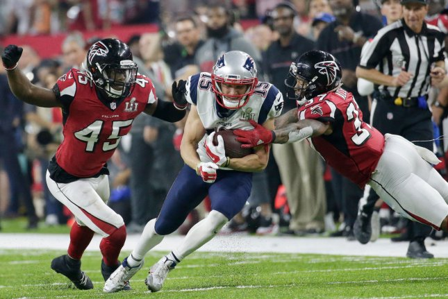 New England Patriots wide receiver Chris Hogan (15) is tackled by Atlanta Falcons middle linebacker Deion Jones (45) and free safety Ricardo Allen (37) on an 18-yard reception in Super Bowl LI on February 5, 2017 at NRG Stadium in Houston. Photo by John Angelillo/UPI