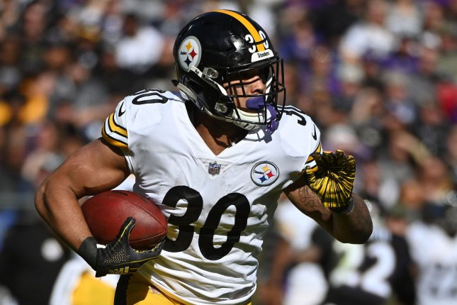 Pittsburgh Steelers running back James Conner looks for room to maneuver during a game against the Baltimore Ravens on November 4, 2018. Photo by Kevin Dietsch/UPI