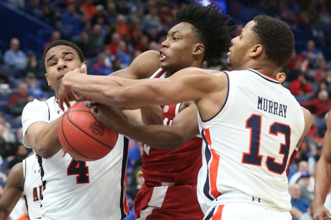 Auburn's Chuma Okeke (4) is done for the remainder of the NCAA Tournament after he tore his ACL in second half of Friday night's Sweet 16 victory over North Carolina. File Photo by BIll Greenblatt/UPI