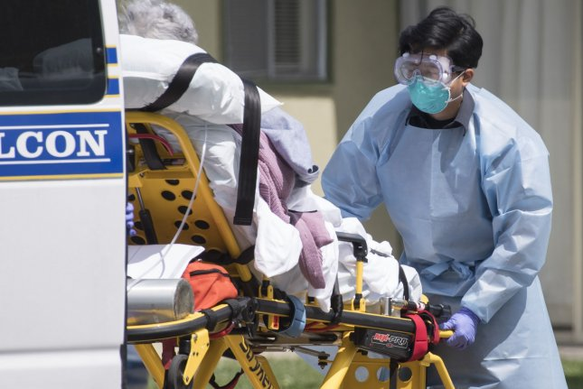 A patient is moved out of Gateway Care and Rehabillition Center, a skilled nursing facility in Hayward, Calif., in April. Photo by Terry Schmitt/UPI
