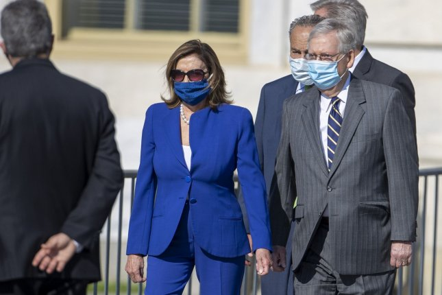 House Speaker Nancy Pelosi and Senate Republican leader Mitch McConnell arrive at the U.S. Capitol Wednesday for a memorial service honoring Rep. John Lewis. Negotiations for the next coronavirus relief package ended Friday as Congress adjourned. Photo by Tasos Katopodis/UPI