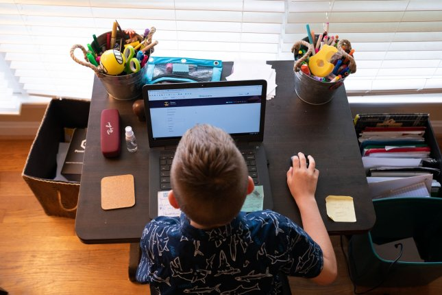 A student participates in remote learning. The pandemic has taken a particular toll on kids with special needs, experts say. Photo by Kevin Dietsch/UPI