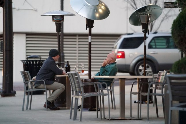 While three U.S. states, and parts of other communities, have moved to reopen indoor dining in the last week, new CDC research directly links eating inside restaurants -- especially without mask mandates -- to increased COVID-19 cases and deaths. File Photo by Bill Greenblatt/UPI