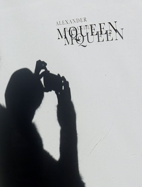 A mourner takes a picture at an Alexander McQueen store on the day of his death in New York City on February 11, 2010. UPI/John Angelillo