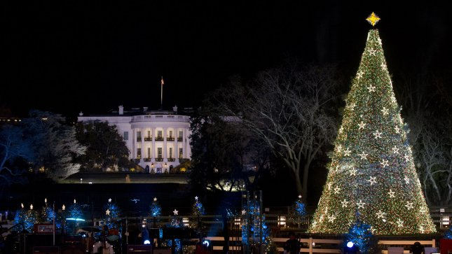 the national christmas tree is seen illuminated next to the white house during the national christmas tree lighting ceremony on the grounds of president - White House Christmas Tree Lighting